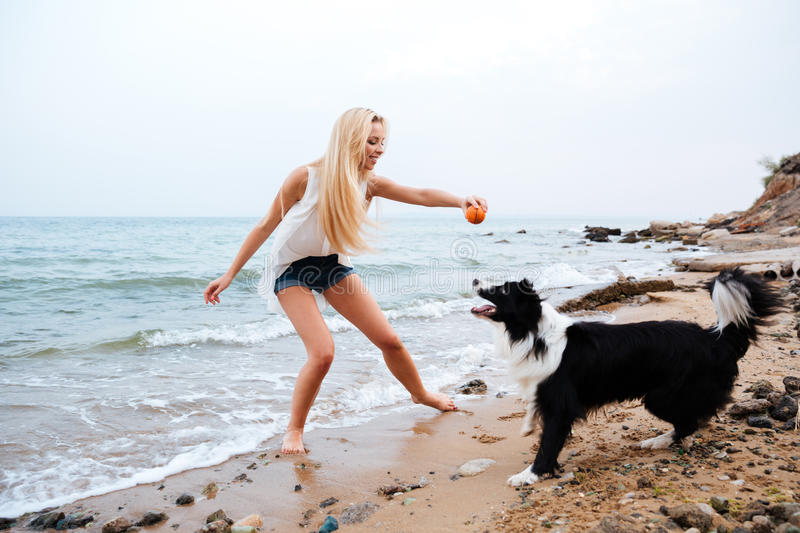 FitBark_person_dog_beach | 10 Fun Ways to Exercise Your Dog
