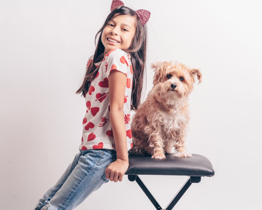 FitBark_child_girl_sitting_dog_small-1030x824 | 8 Lessons Pet Ownership Can Teach Your Child